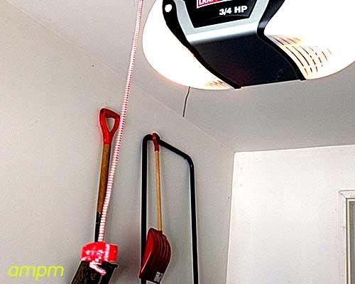 A garage door emergency release red wire